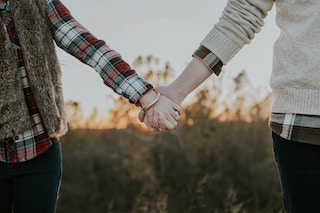 Couple holding hands after successful couples counselling.